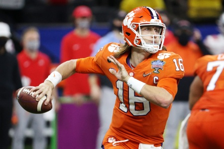 Trevor Lawrence of the Clemson Tigers looks to pass in the second half against the Ohio State Buckeyes during the College Football Playoff semifinal game at the Allstate Sugar Bowl at Mercedes-Benz Superdome on January 01, 2021 in New Orleans, Louisiana.