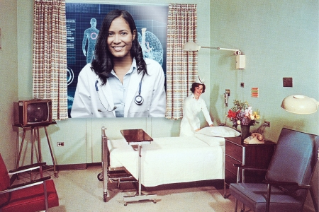 A doctor conferencing into a hospital room via a large screen