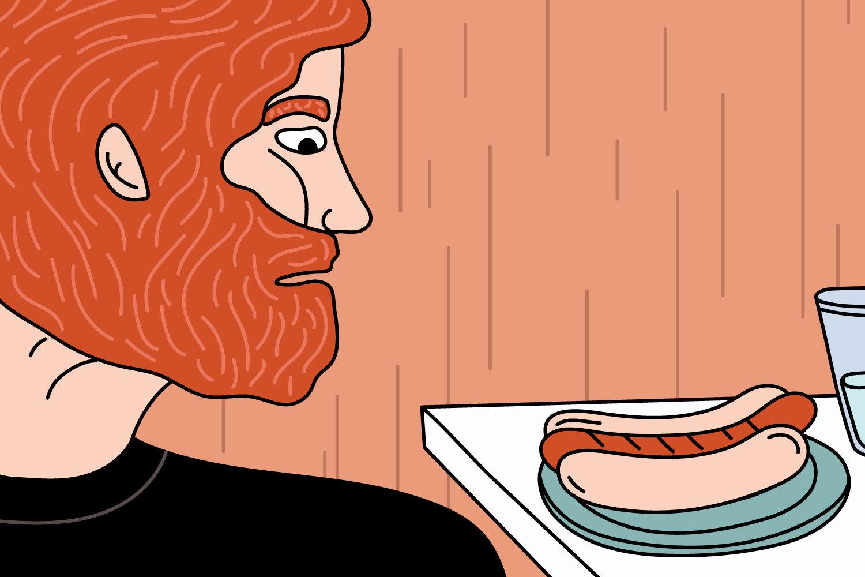 На иллюстрации изображен рыжеволосый мужчина, смотрящий на хот-дог