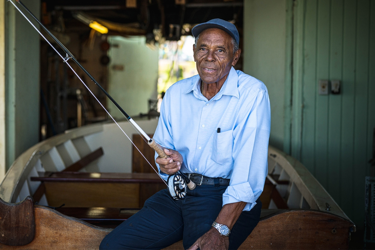 Fly fishing guide Ansil Saunders holds a fishing rod on Bimini