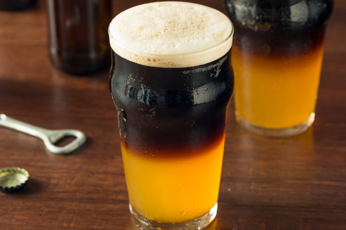 Irish Layered Black and Tan Beer with Lager and Stout in a glass on a bar