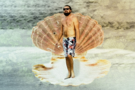 Leonardo DiCaprio in a swimsuit standing in a giant seashell