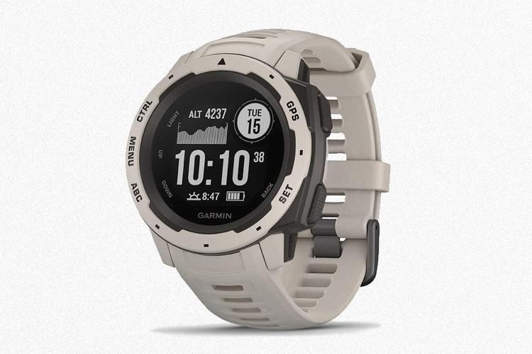 Garmin Instinct GPS Watch on a grey background