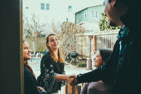 Airbnb host greets new guests at his residence in San Francisco