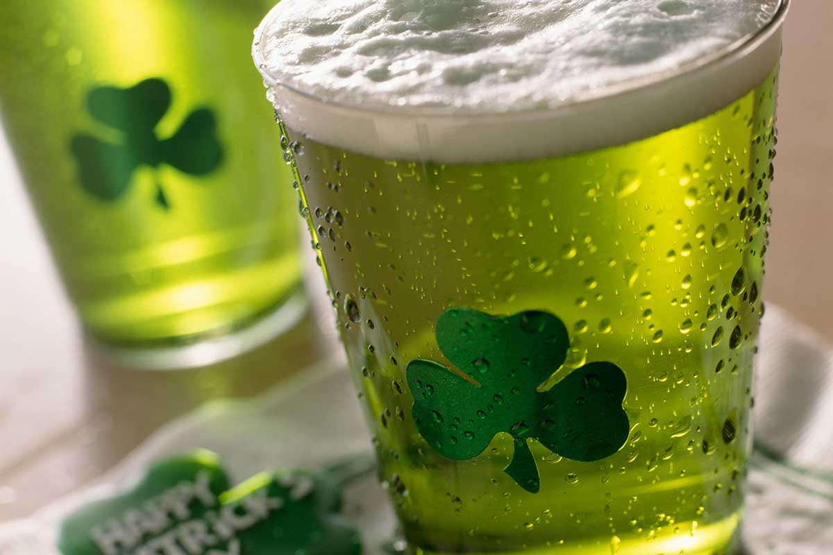 A close-up of shamrock glasses with green bar on St. Patrick's Day