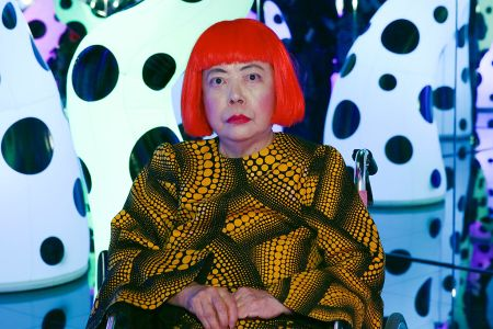 Artist Yayoi Kusama wearing her signature bright red wig