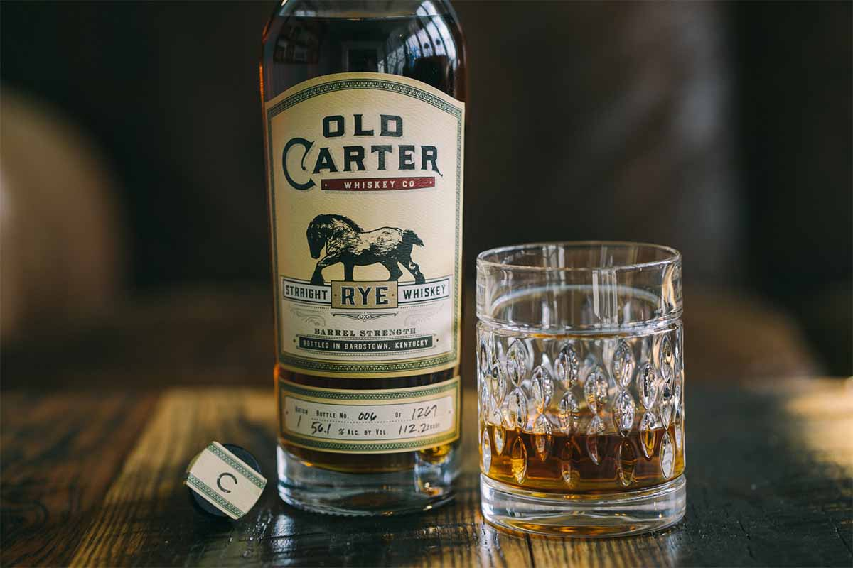 Old Carter rye in a glass and in a bottle
