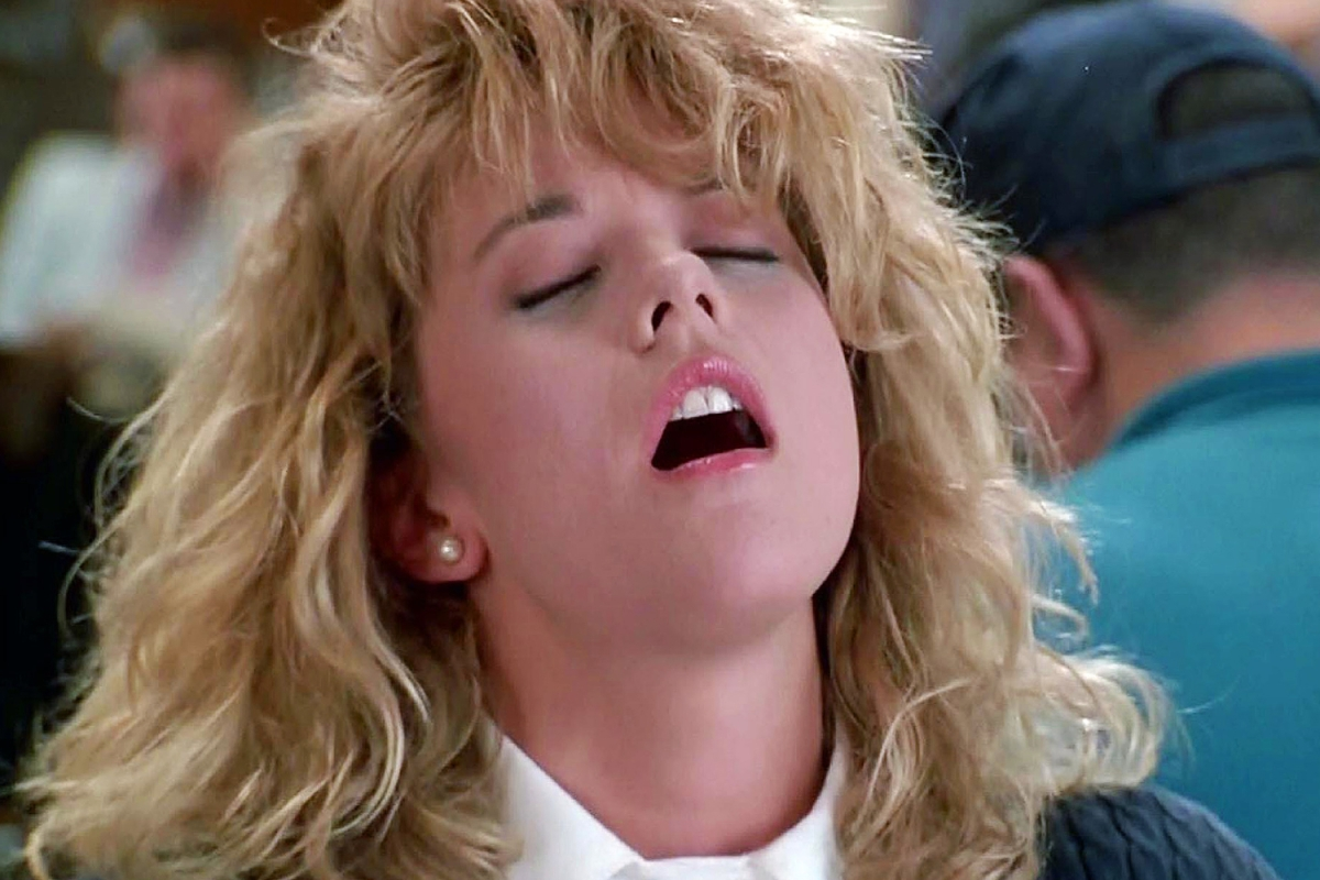 still from When Harry Met Sally shows Meg Ryan playing Sally Allbright faking an orgasm