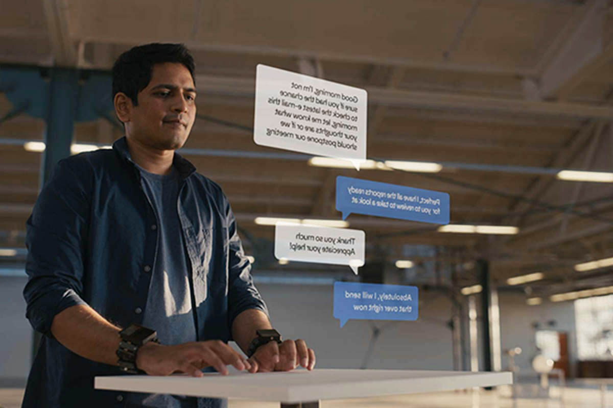"A man ""virtual typing"" using wristbands, sensors and AI"