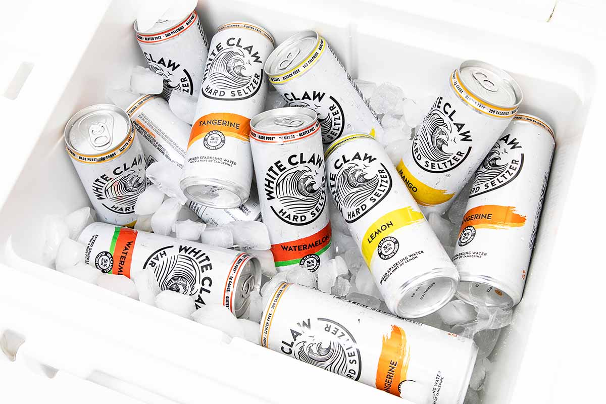 The different flavors of White Claw hard seltzer in a cooler
