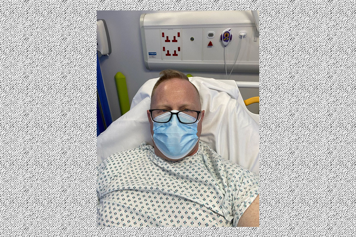 Jonathan Frostick in the hospital after suffering a heart attack