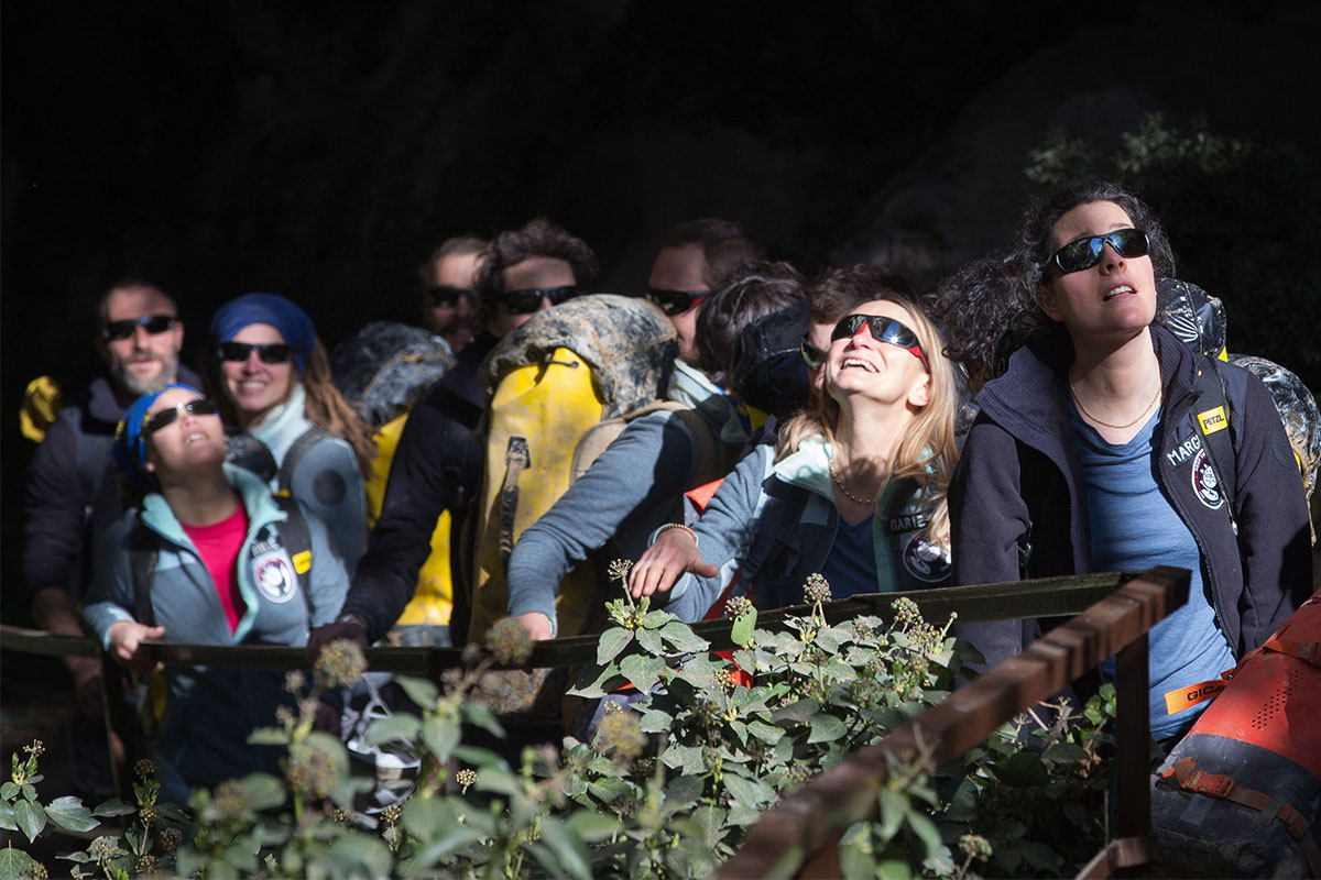 Volunteers with sunglasses on emerge from the Deep Time experiment in a French cave