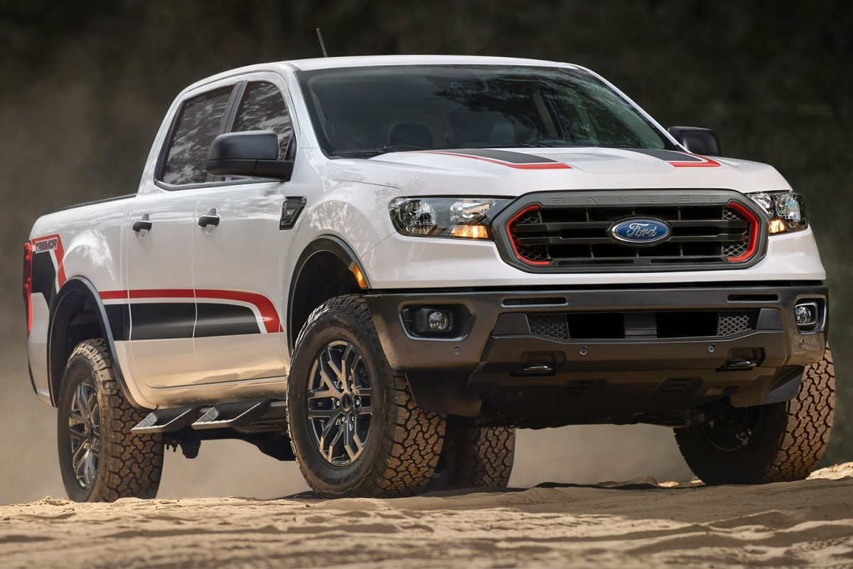 A white 2021 Ford Ranger Tremor off-road pickup truck sitting on dirt