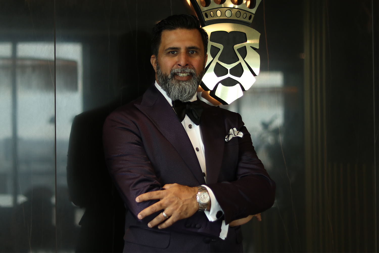 Aashif Jamani posing with his arms crossed at menswear boutique King & Bay