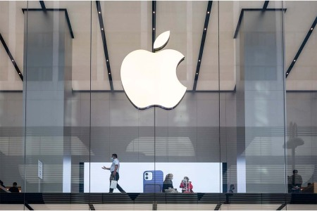 Customers are seen at the American multinational technology company Apple store in Hong Kong