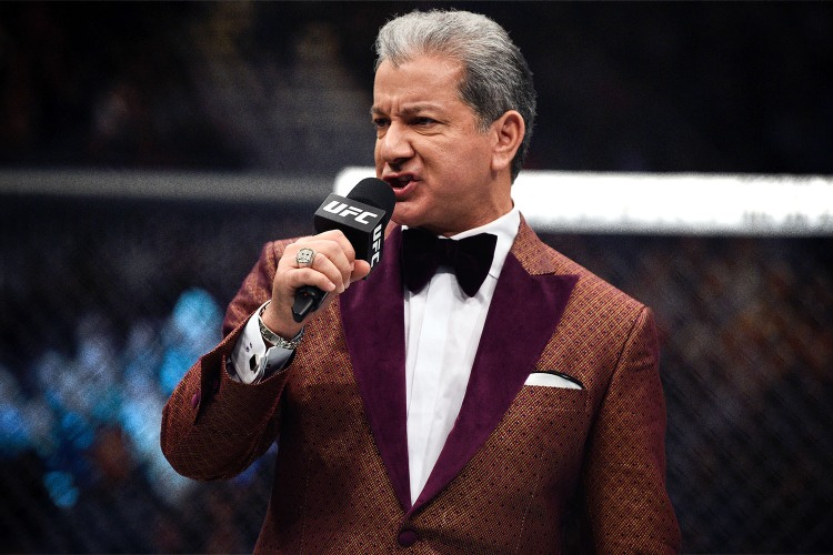 Bruce Buffer announcing a UFC fight in a King & Bay smoking jacket
