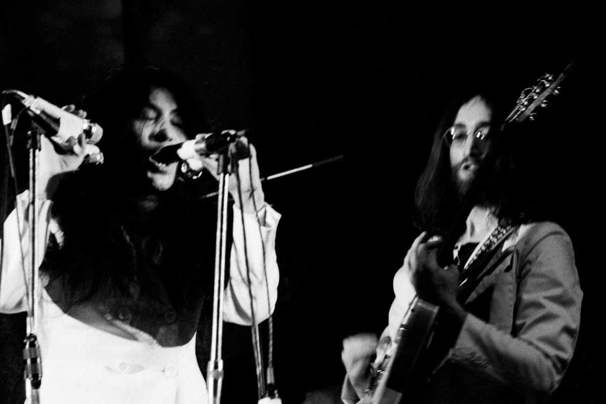 Yoko Ono and John Lennon performing on stage with the Plastic Ono Band at UN Childrens Fund concert