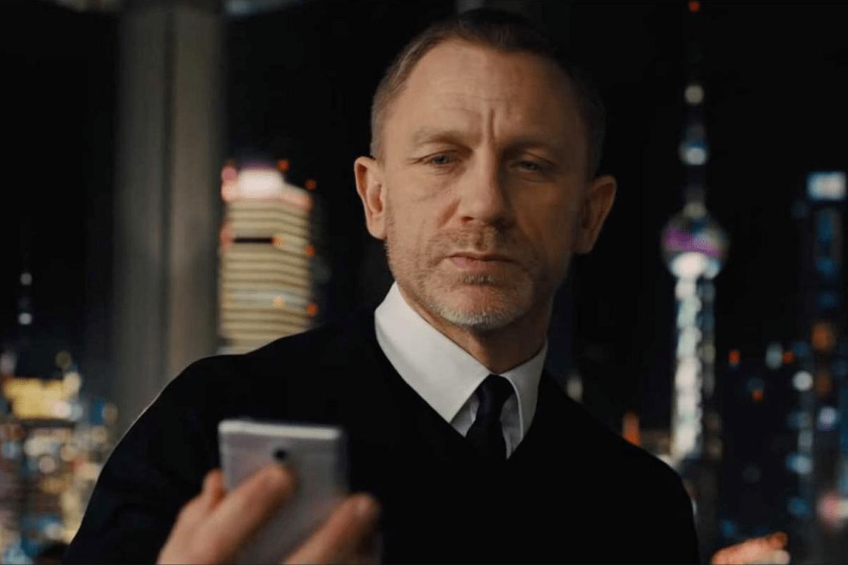 "Daniel Craig as James Bond looking at a phone in 2012's ""Skyfall"""