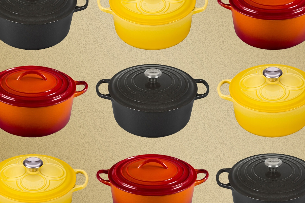 Le Creuset enameled cast iron Dutch ovens in black, orange and yellow