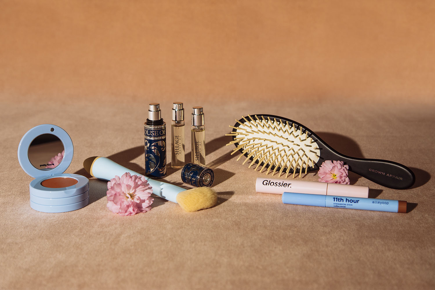 assorted makeup, perfume, brush and applicators for mothers day