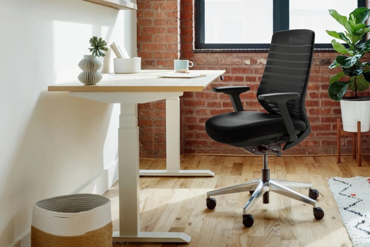 An ergonomic office chair and work desk from furniture company Branch