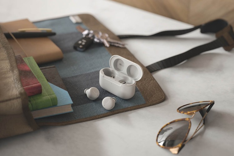 The glacier white version of the Amazon Echo Buds (2nd gen) on a desk; the earbuds just went up for pre-order.