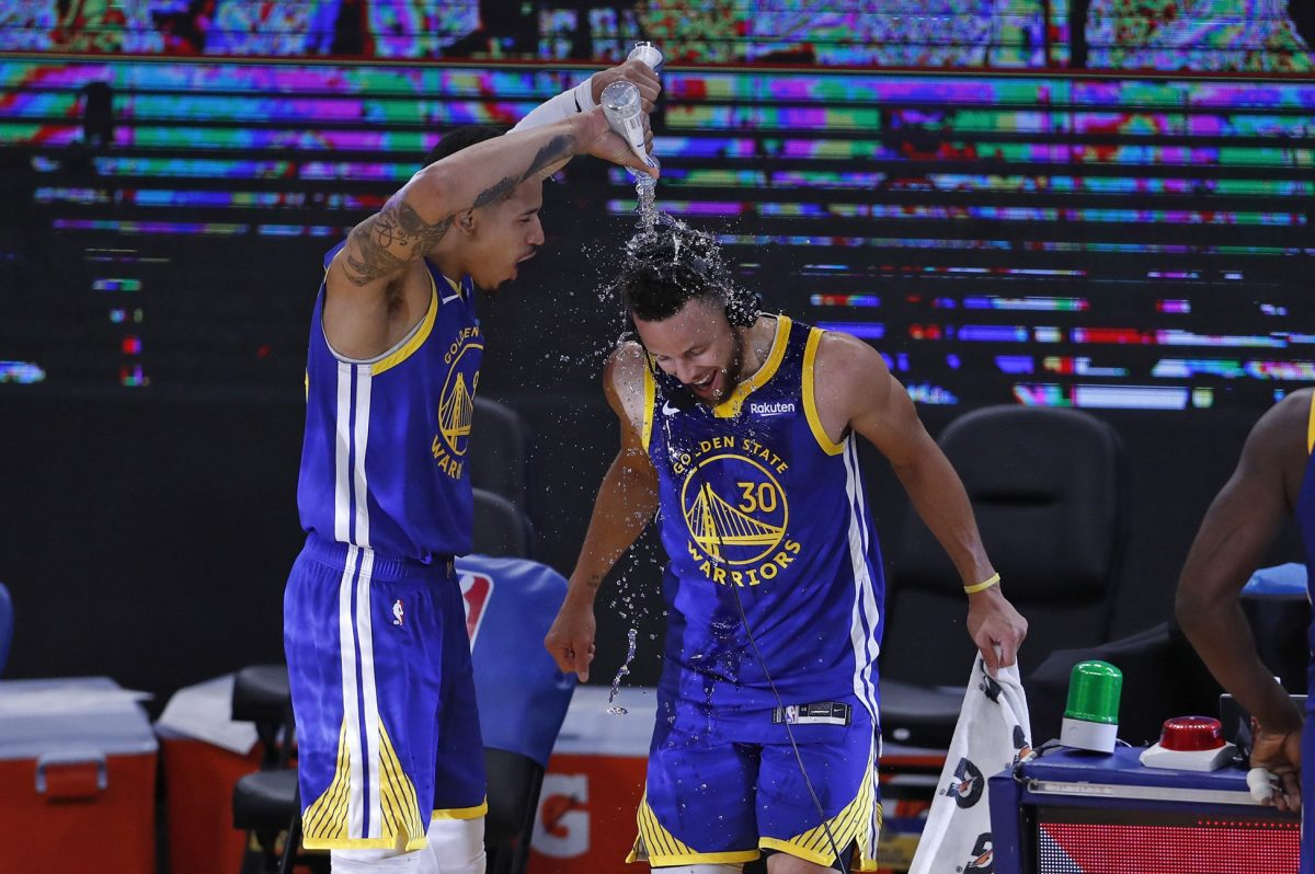 Steph Curry being doused with water