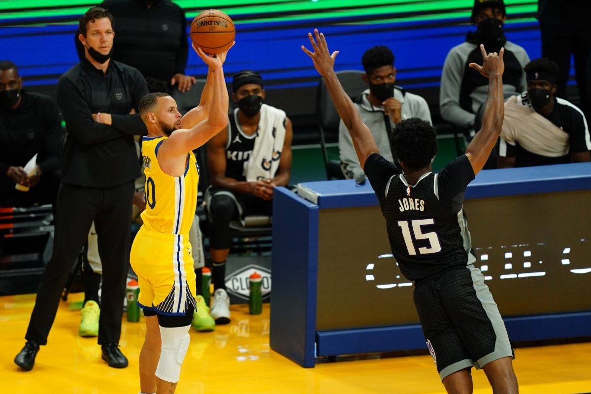 Stephen Curry of the Golden State Warriors shoots a three against the Sacramento Kings