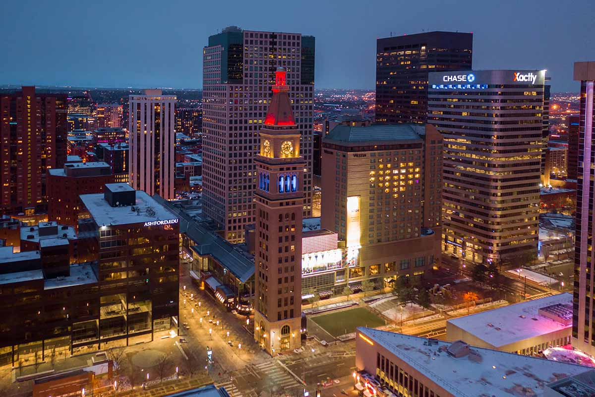 16th Street mall clock tower lit up for health care workers during Covid-19 stay at home policy. Shot with the drone.