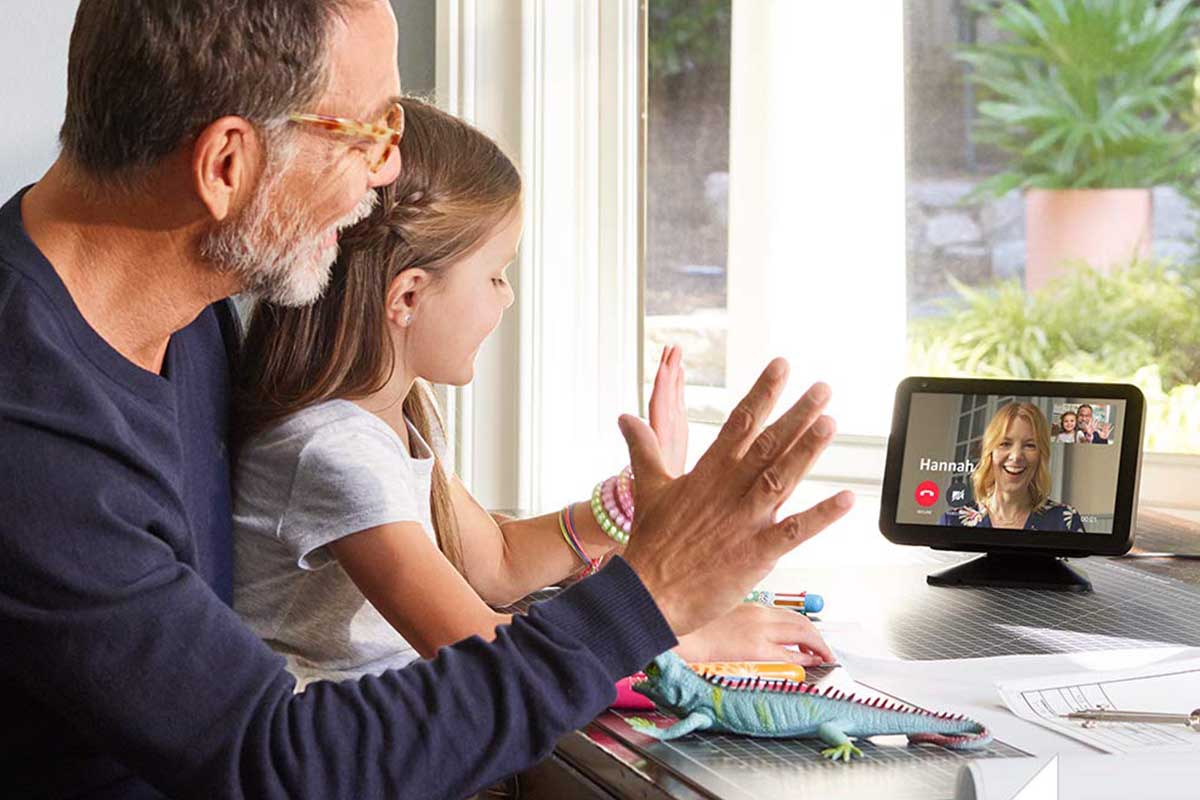A father and daughter waving to their mom through the Amazon Echo Show 8, now on sale at Woot