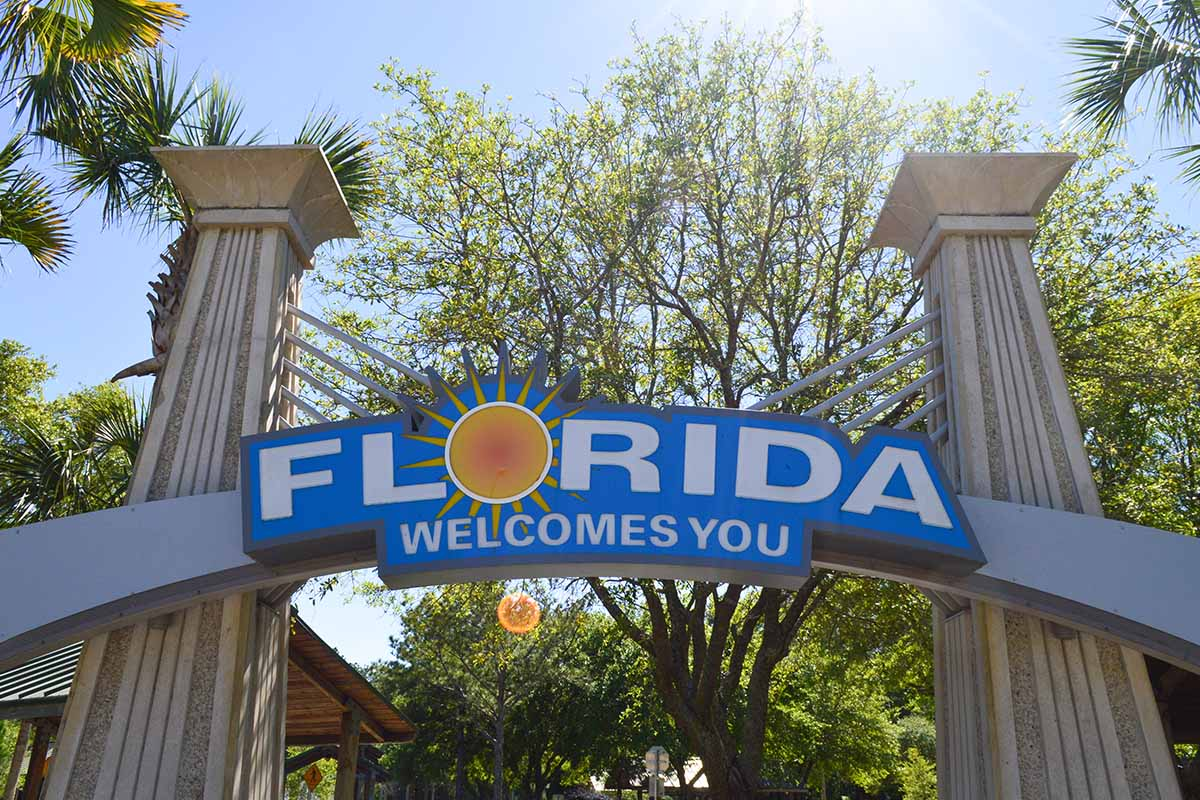 """a sign saying """"Florida Welcomes You."""" The state had several areas in Tripadvisor's most popular summer destinations list."""