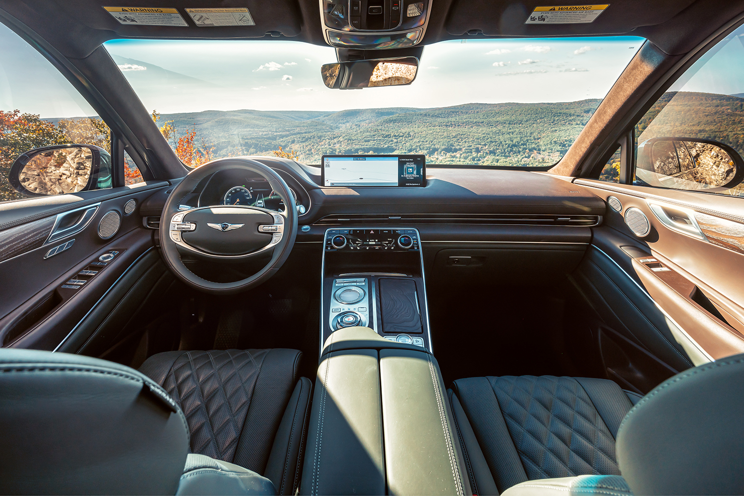 The front two seats and the dashboard on the 2021 Genesis GV80 SUV