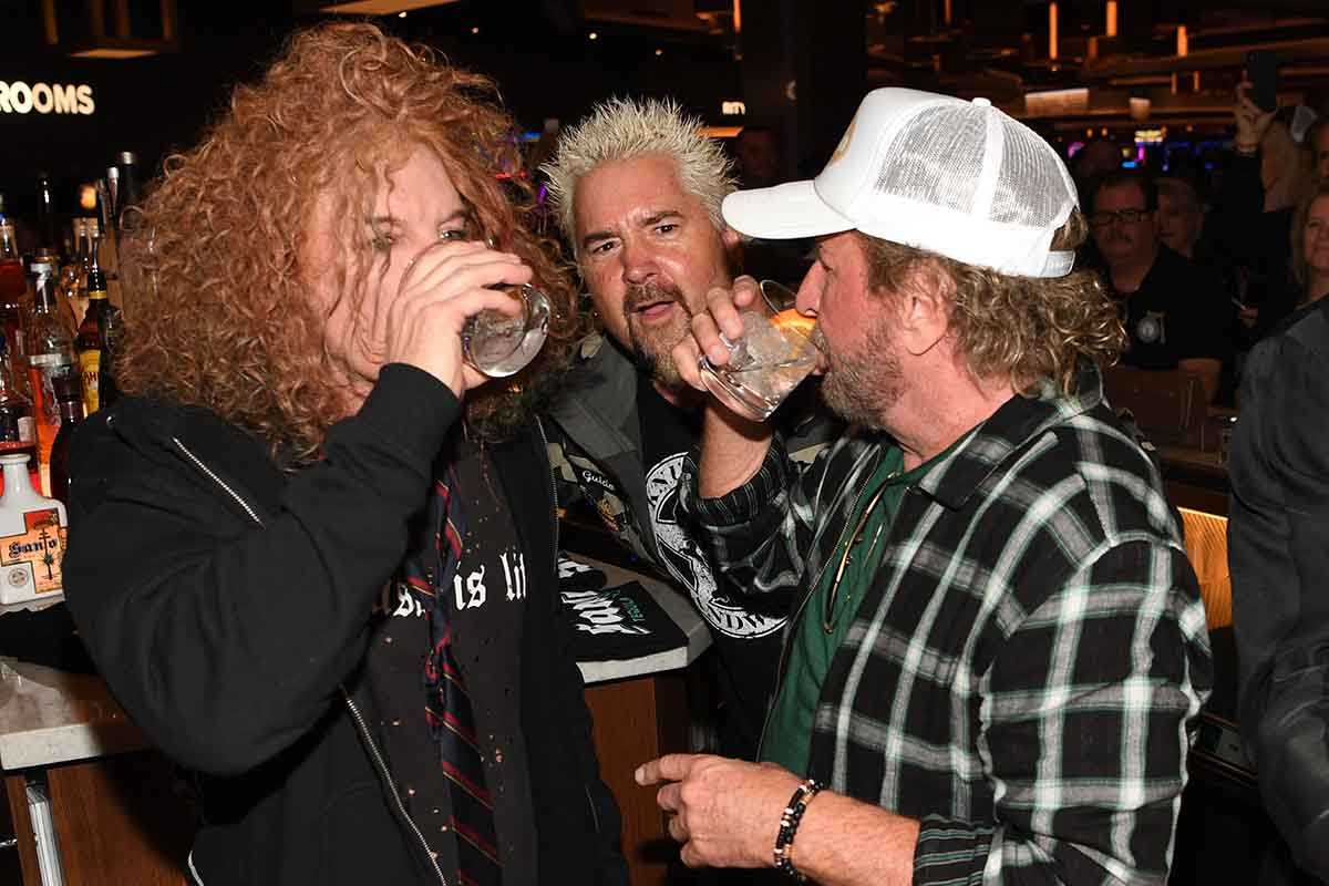 Comedian Carrot Top, restaurateur/tv personality Guy Fieri and musician/entrepreneur Sammy Hagar celebrate the reinvention of The STRAT Hotel, Casino & SkyPod with Santo Blanco Tequila and Sammy's Beach Bar Rum on January 22, 2020 in Las Vegas, Nevada