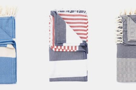 Three Turkish towels on a grey background