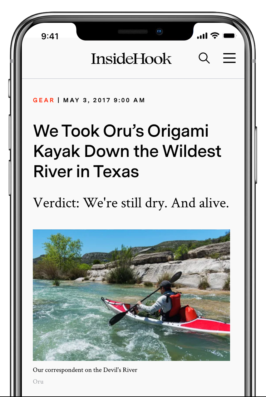 iphone with article about kayaking wild rivers in texas