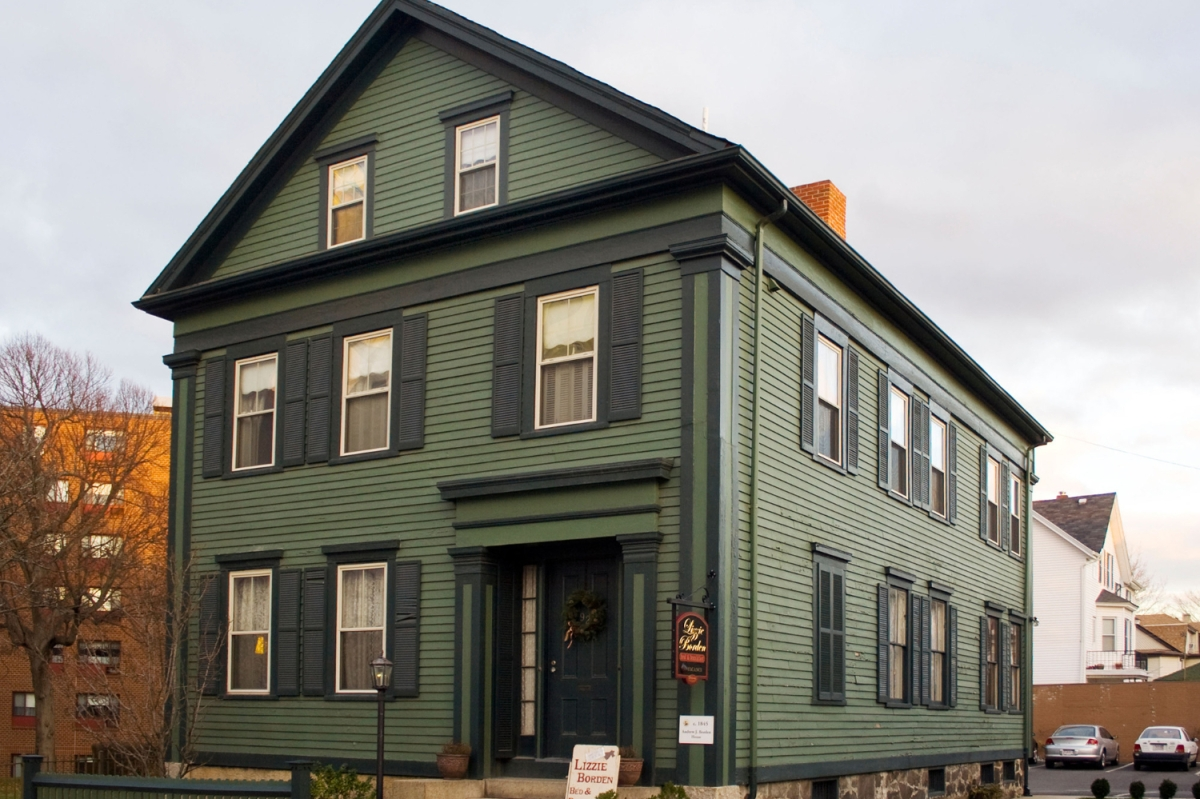 Exterior shot of dark green Greek Revival style home in Fall River, Massachusetts