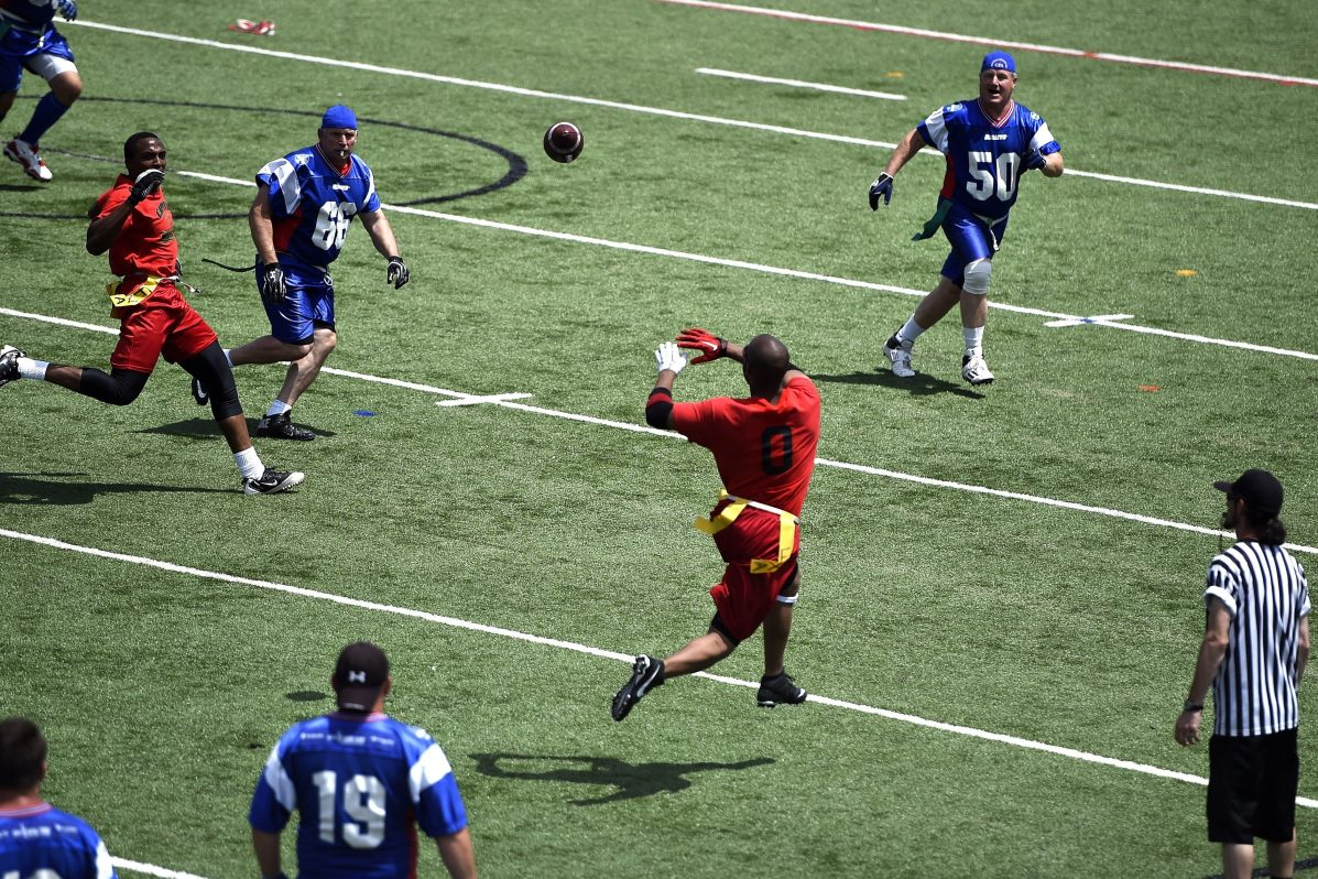 Men play flag football