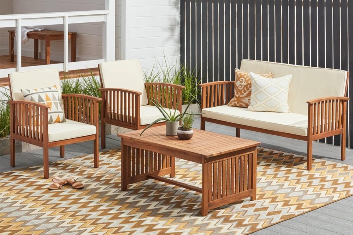 A four-piece set of Christopher Knight Home Carolina Acacia patio furniture