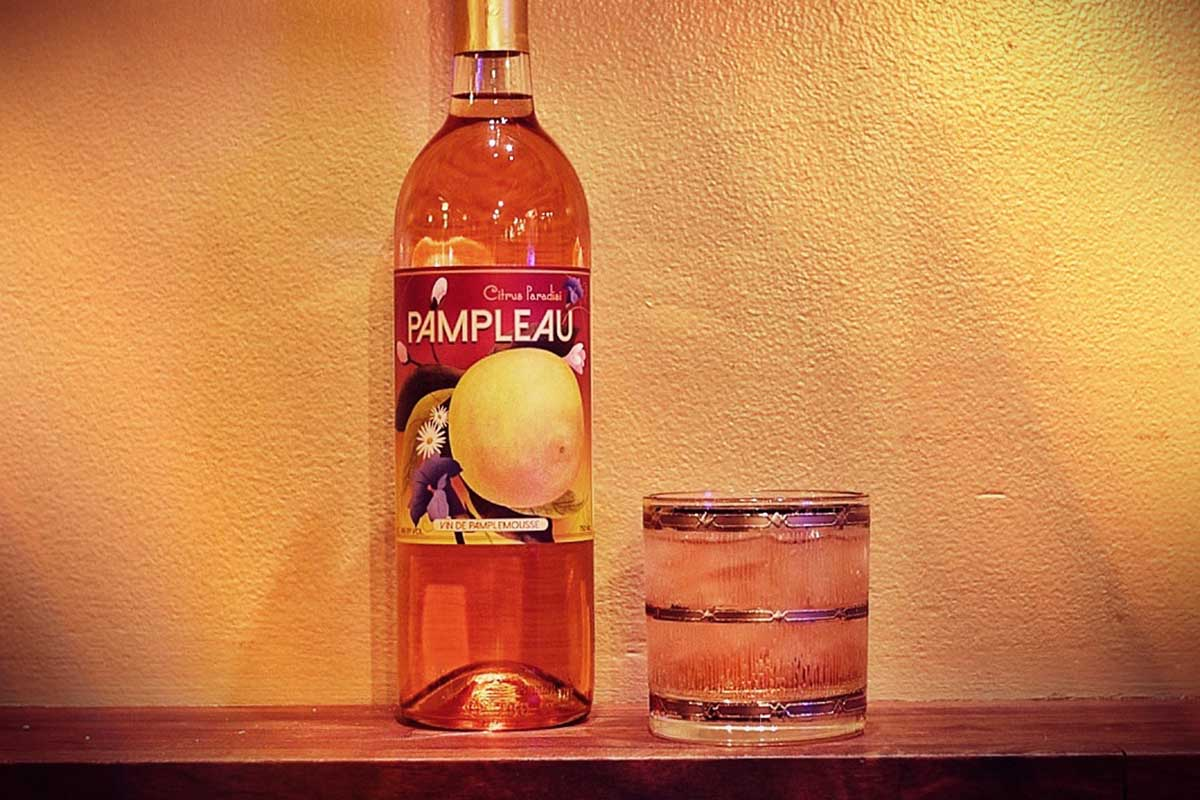 a bottle of Pampleau and it served in a glass