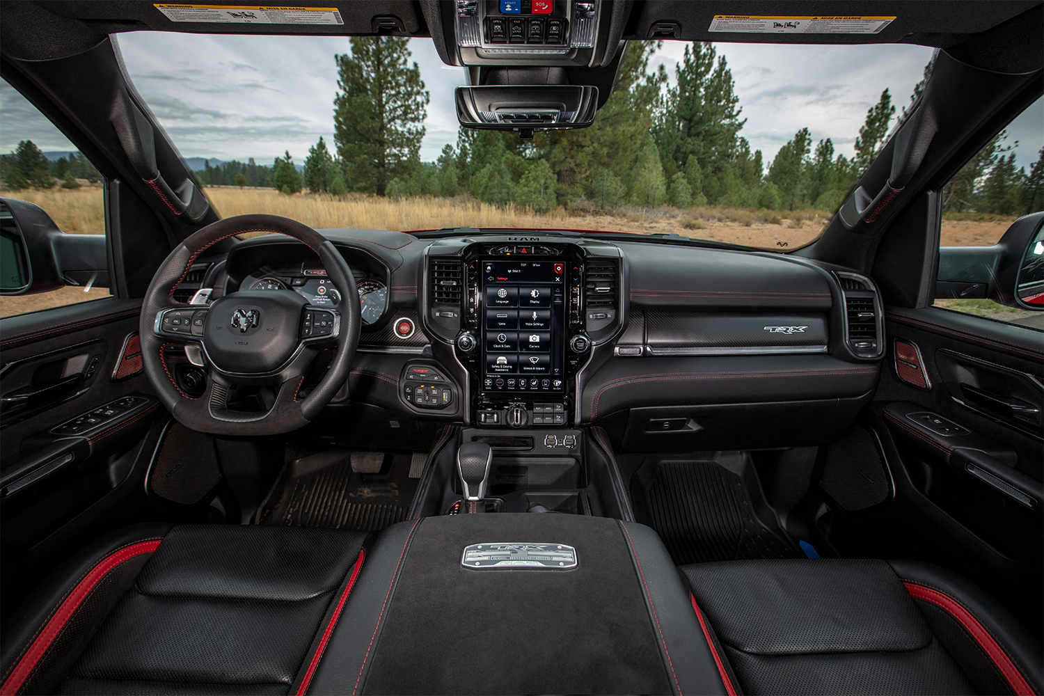 The front two seats in the interior of the 2021 Ram 1500 TRX pickup truck