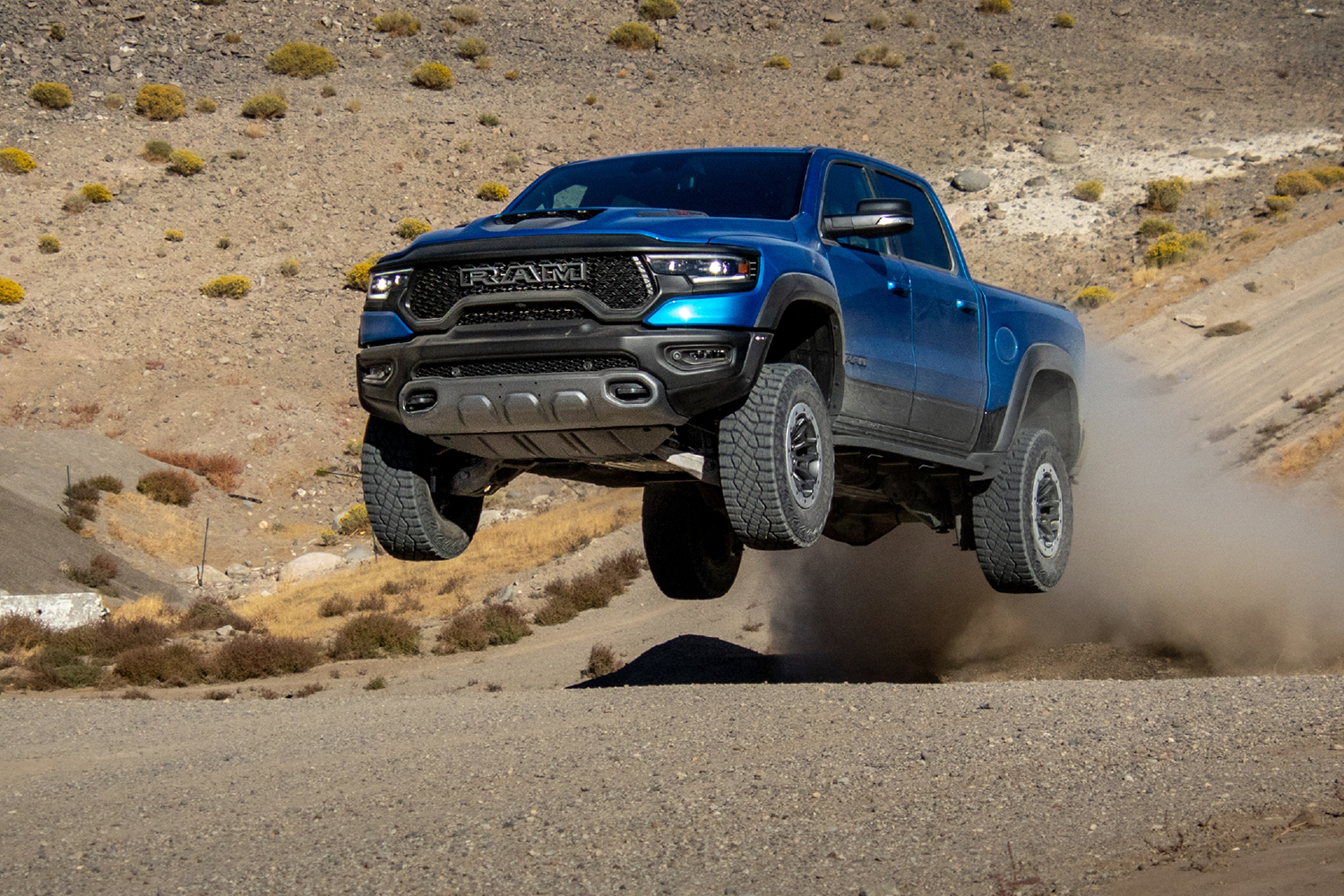 A blue 2021 Ram 1500 TRX pickup truck gets some airtime