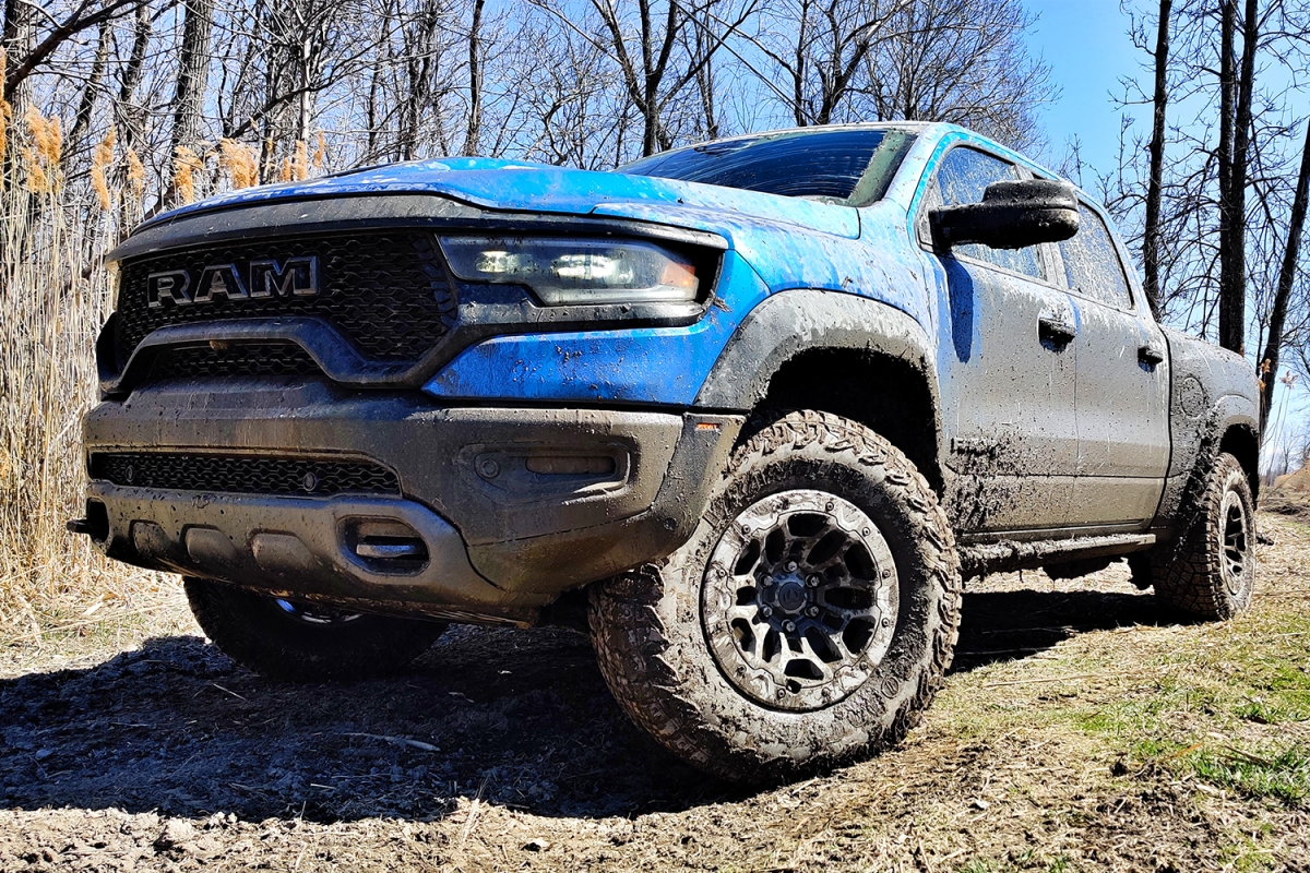 A blue 2021 Ram 1500 TRX off-road pickup truck after driving through the mud