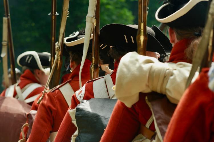 Revolutionary War reenactors standing in a line