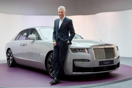 Rolls-Royce Motor Cars CEO Torsten Müller-Ötvös next to the Ghost car