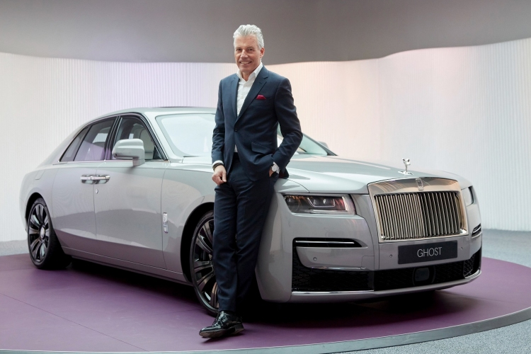 Rolls-Royce Motor Cars CEO Torsten Müller-Ötvös next to the Ghost car