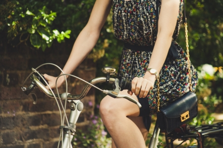 woman in sundress riding bike