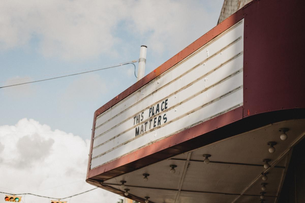 """Theater awning with letters that read """"This place matters"""""""