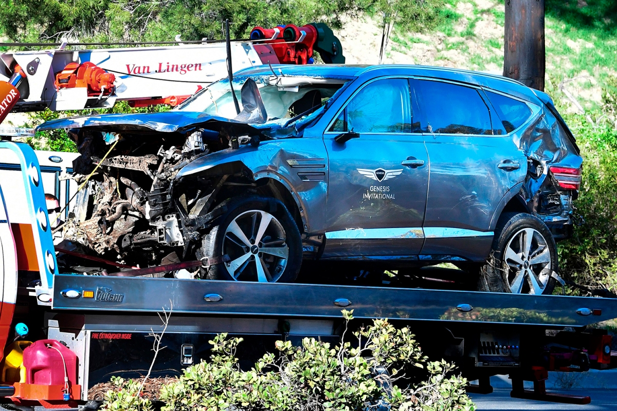 A tow truck recovers the Genesis GV80 SUV driven by golfer Tiger Woods in Rancho Palos Verdes, California, on February 23, 2021, after a rollover accident
