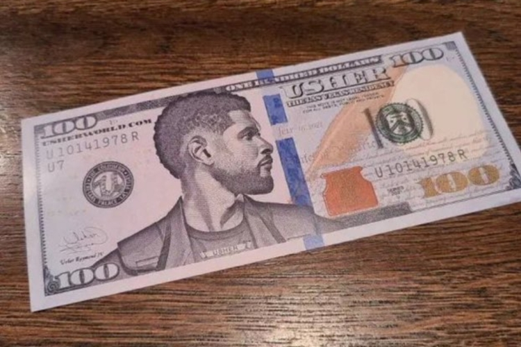 A $100 bill with Usher's face on it