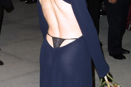 Closeup of Gillian Anderson wearing a black G-string thong under a navy blue backless dress at the 2001 Oscars